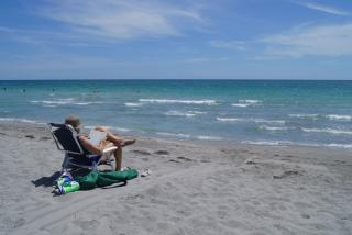 Reading on one of Sarasota County's beautiful beaches