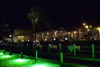 night outdoor view of Ophelias by the bay restaurant in sarasota florida