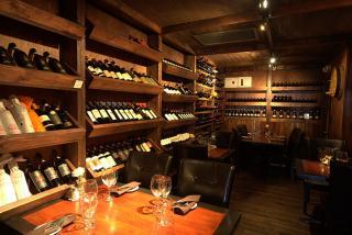 Custom wine cellar and seating at Café Gabbiano