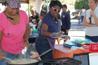 Tashika Newsom and Rosalyn Thomas just make really, really good shrimp, corn and sweet potato pie. Photo by Jessi Smith