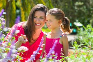 Mother and Daughter looking at Garden Life in Mothers Day in Sarasota 2018