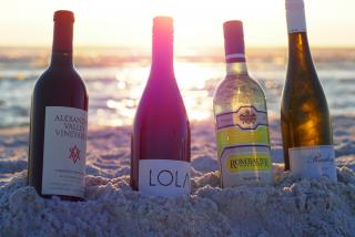 Four wines from 2019 Forks and Corks on a Sarasota beach