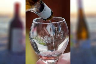 Wine pouring into a Forks and Corks glass in Sarasota